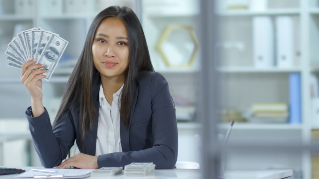 Lady sitting at desk with money