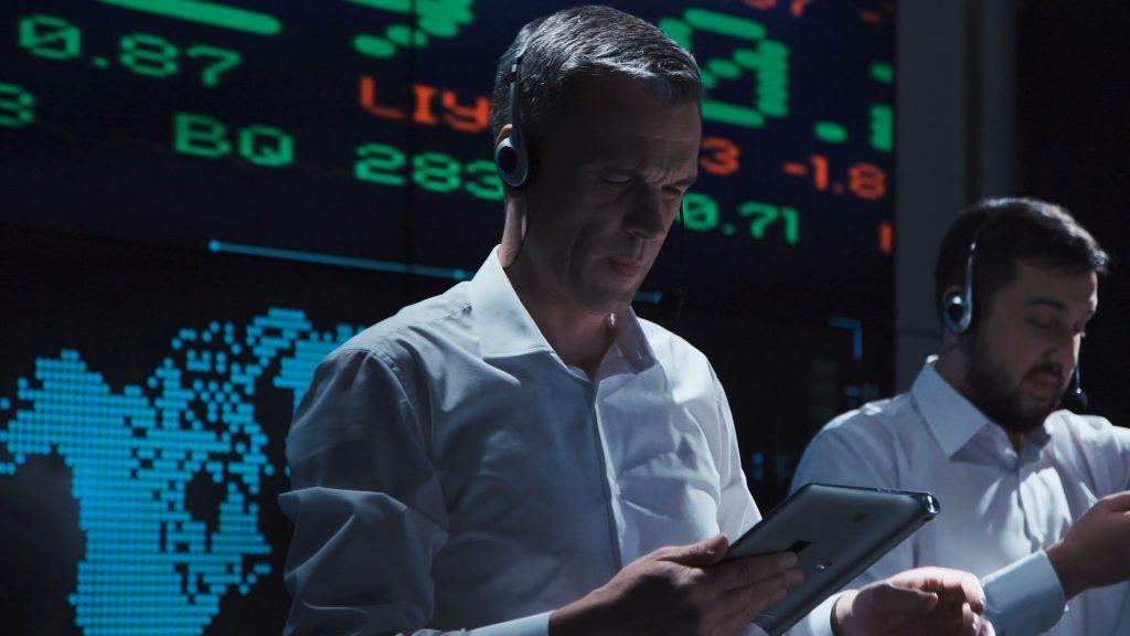 Stock trader looking at tablet
