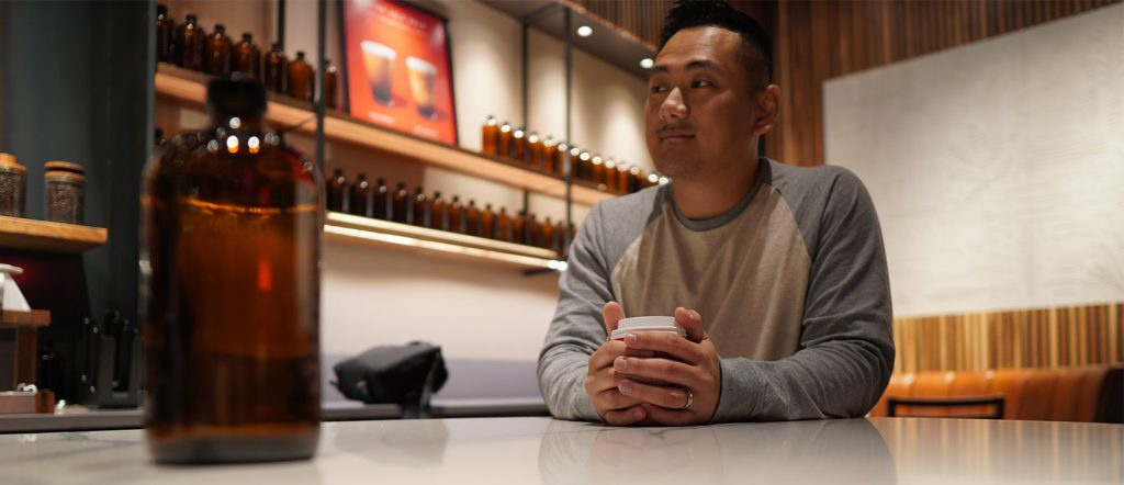 Daniel sitting at coffee table