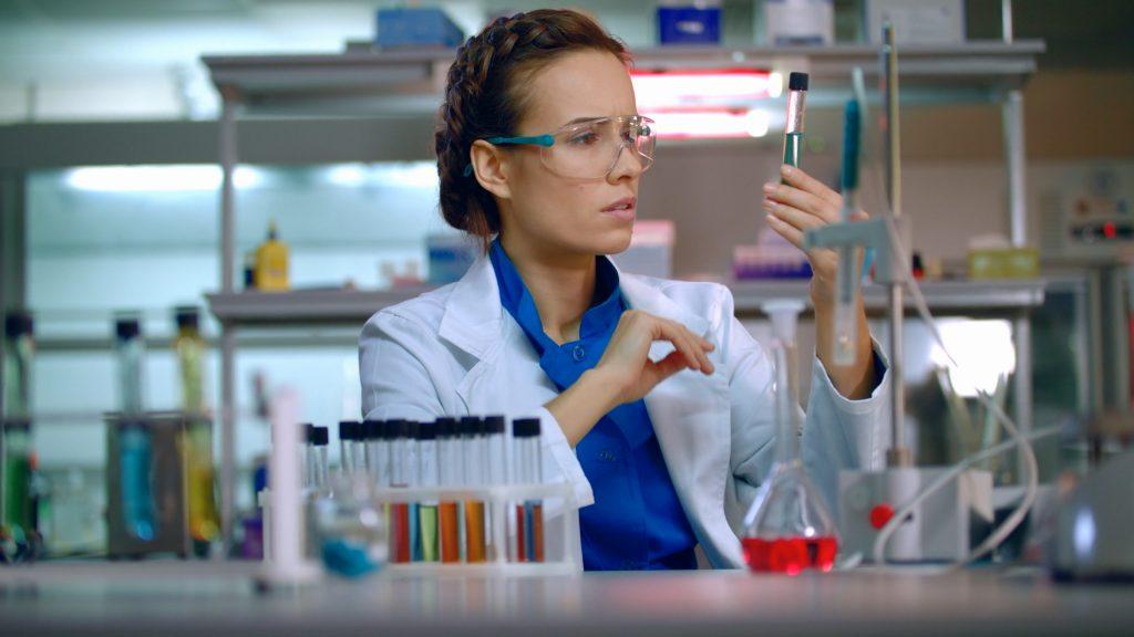 Scientist looking at vials