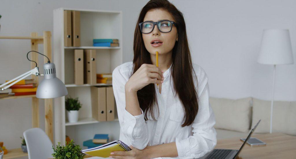 Lady sitting at desk pondering