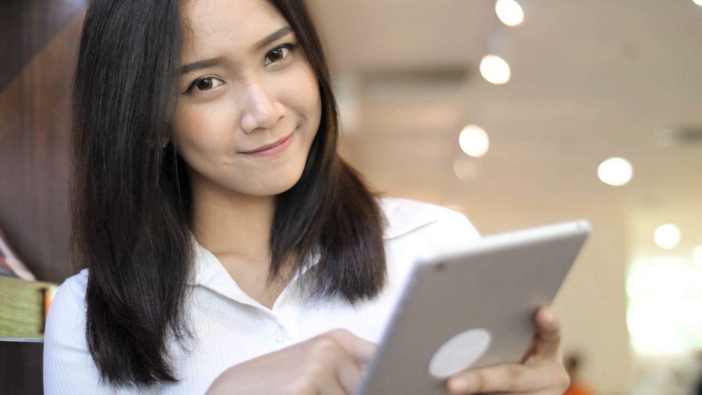 Lady looking at ipad