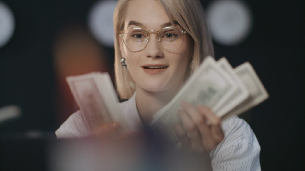 Lady counting money happily