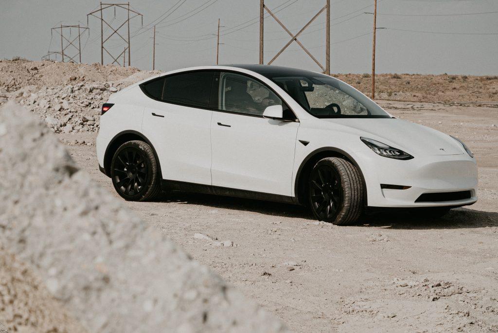 White Model Y on Gravel road