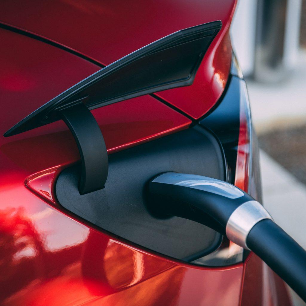 Red Tesla Charging