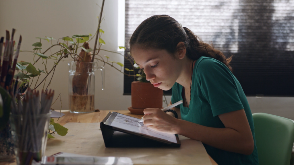 Girl drawing on tablet