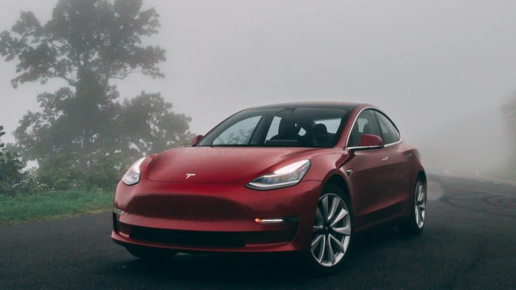 Red Tesla in Fog